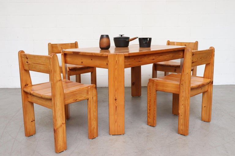 Ate van Apeldoorn style pine dining set; table and 4 chairs. Tabletop with clipped corner and angle legs. Heavy and wide set matching chairs all in original condition with visible signs of wear consistent with its age and usage. Chairs measure: