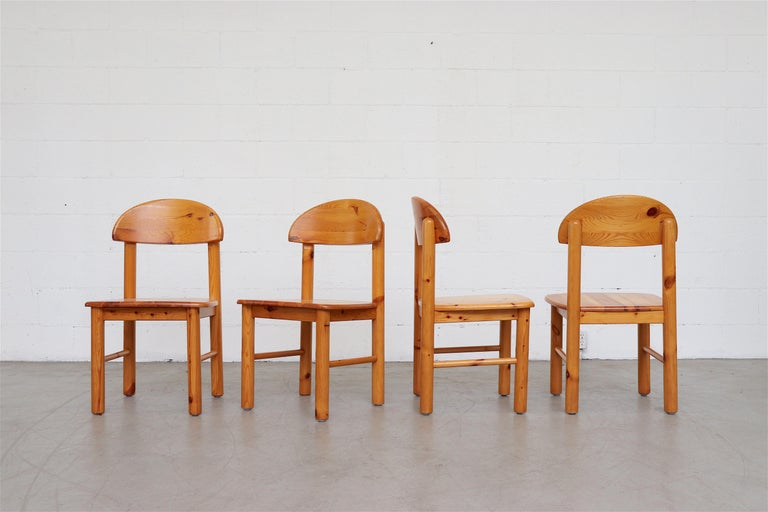 Set of 6 Rainer Daumiller style pine dining chairs. Four armless chairs and two with armrests. In original condition with signs of wear consistent with their age and use. Side chairs measure: 19.5 x 18 x 18.25/34.25.
