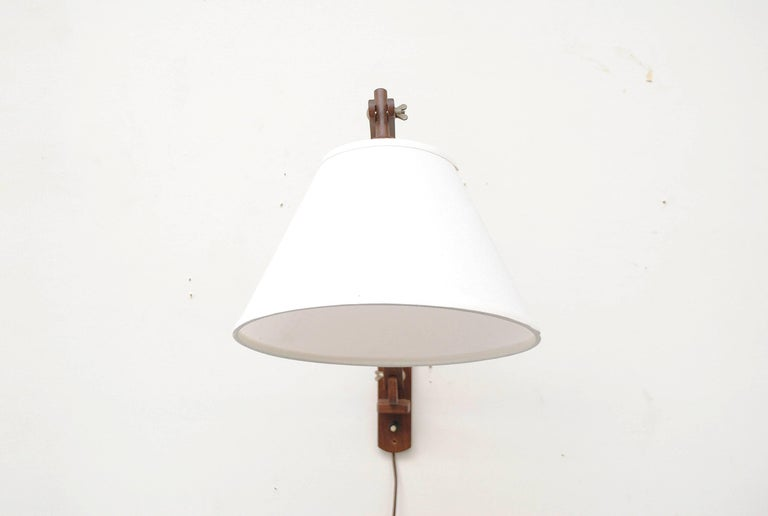 Teak swan neck wall lamp with adjustable positioning. Newly made white linen cone shade. Teak in good original condition.