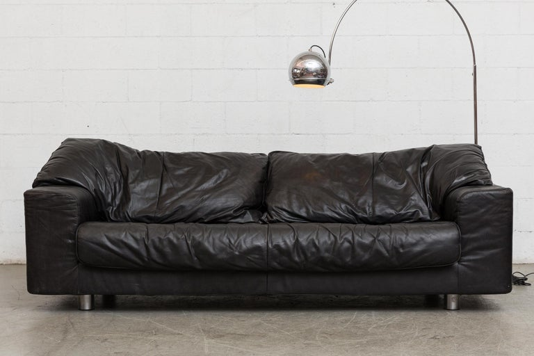 Large comfy midcentury three-seat sofa in black leather. Designed by Gerard Van Den Berg for Montis. Zip on back cushions four short chrome legs. Original manufacturer tag photographed. Good original condition. Set price.
