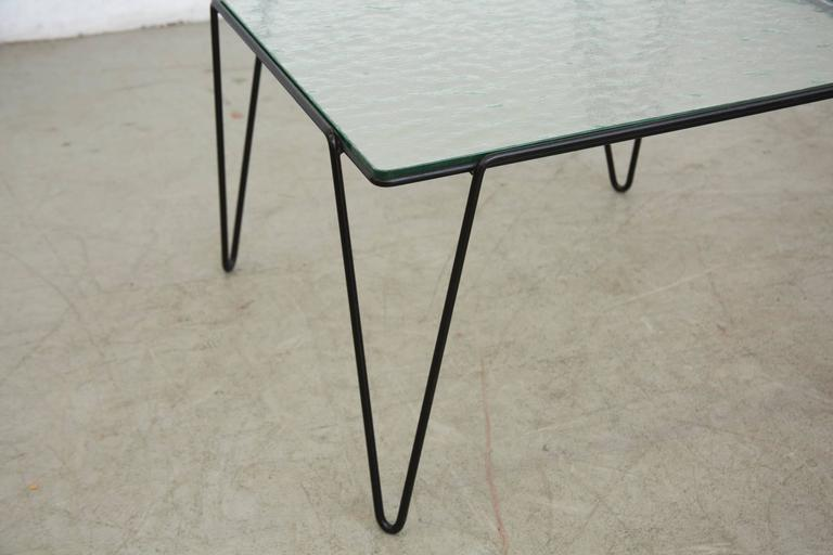 A Bueno De Mesquita For Spurs Glass And Metal Side Table