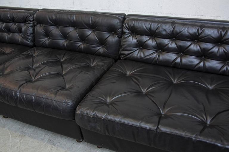 Grand Black Leather Tufted Sectional Sofa With Ottoman At