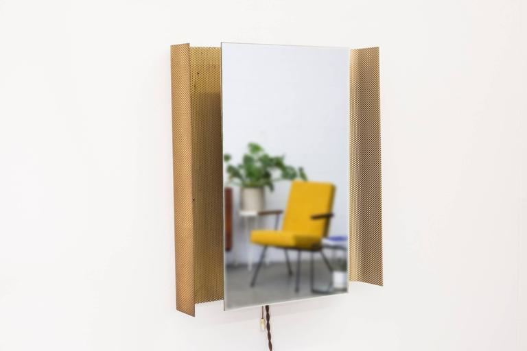 Rectangle perforated metal frame with back lit mirror and pull string switch. Original condition with visible patina by Mathieu Mategot for Artimeta, 1950s.