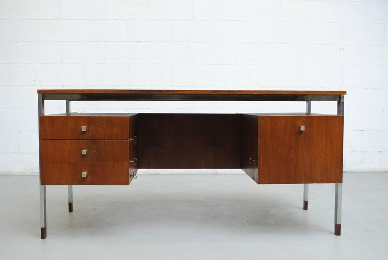 Gorgeous Alfred Hendrickx attributed teak writing desk by Belform with book shelf and storage on the back side. Steel legs with signature wood feet. Multiple keys for locking the individual drawers and storage, in good original condition with