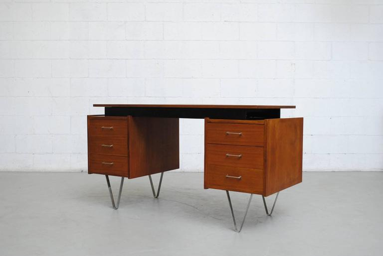 Rare Cees Braakman desk for Pastoe with thick hairpin legs. Side cabinet with sliding birch trays. Stellar and stylish. Good original condition. Minor wear consistent with its age and usage.