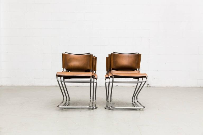Zig zag shaped chrome tubular framed marcel Breuer style chairs with original natural leather seating. In original condition with amazing patina. Set price.