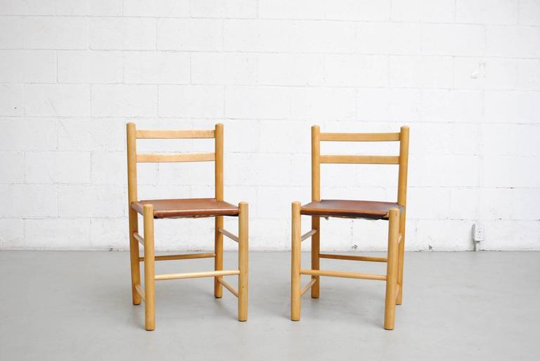 Perriand style birch chairs with primitive construction. Natural leather tanned hyde seats, rope tied to the frame. Original condition - great patina on leather - some staining. Set price.