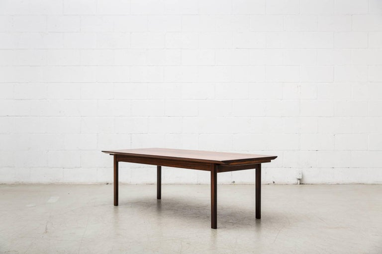 Smart Swedish rosewood coffee table for Seffle Mobelfabrik with two formica topped sliding trays. In good original condition, some signs of wear consistent with its age and usage.