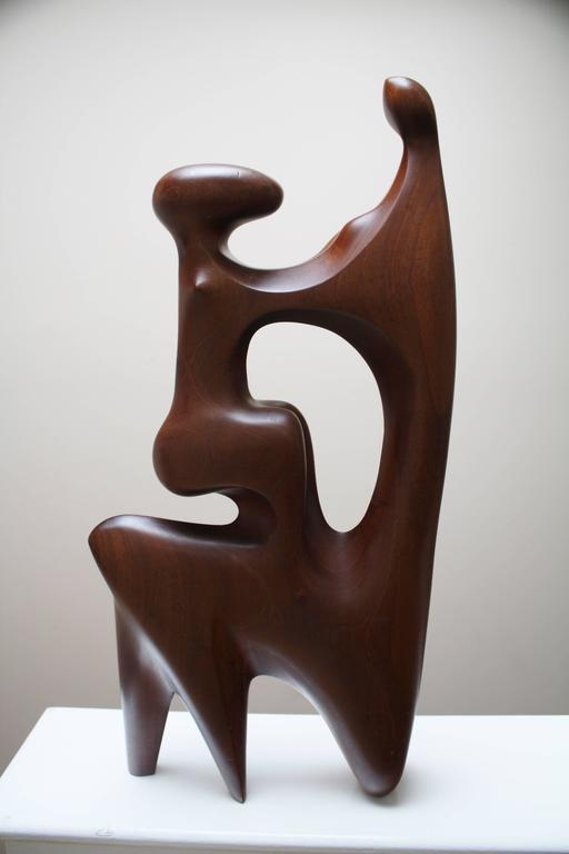 """Large-scale abstract wood sculpture in the form of """"Mother and Child."""" Probably Mid-Century. In the style of Henry Moore."""