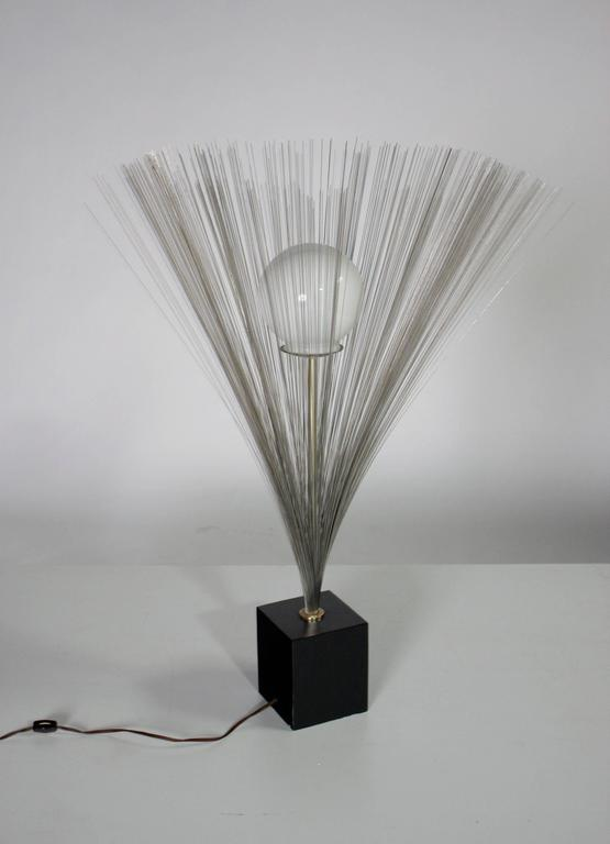 Mid-Century Modern spray sculpture table lamp in the style of Harry Bertoia with a round glass globe. Wired and in good working condition.