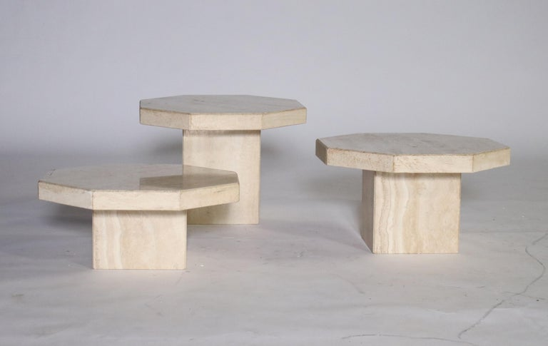 1970s trio of Travertine tables in various heights and removable hexagon-shape tops. Can be used as a cluster of cocktail tables or separate end tables.  Largest 20.5