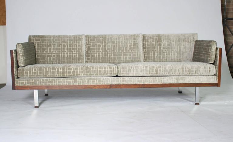 1970s Milo Baughman style rosewood case tuxedo sofa newly upholstered in a silver gray block pattern velvet in excellent condition.