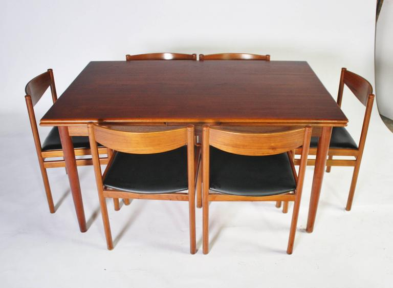 Mid-20th Century Danish Modern Expandable Dining Table and Chairs For Sale