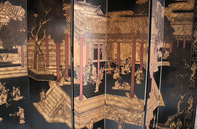 Monumental mid-20th century 12-panel Coromandel Chinese screen with a gold gilt on black lacquered courtyard scene and a bamboo / floral scene on the opposite side. Both sides show a lovely continual landscape painted on carved lacquer wood. All