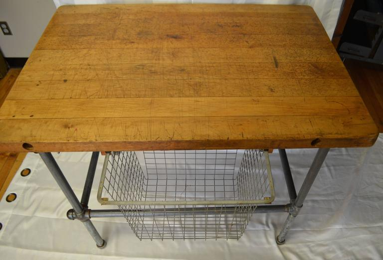 kitchen island work table with maple top and sliding baskets on steel pipe base at 1stdibs