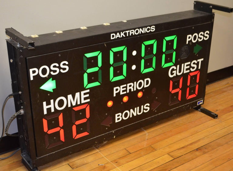 High school basketball scoreboard is neat, clean, fully operational and lightweight with all wiring included as well as control panel. Scoring numbers are much more vibrant red than the camera could depict as is the green of the time. Metal screen