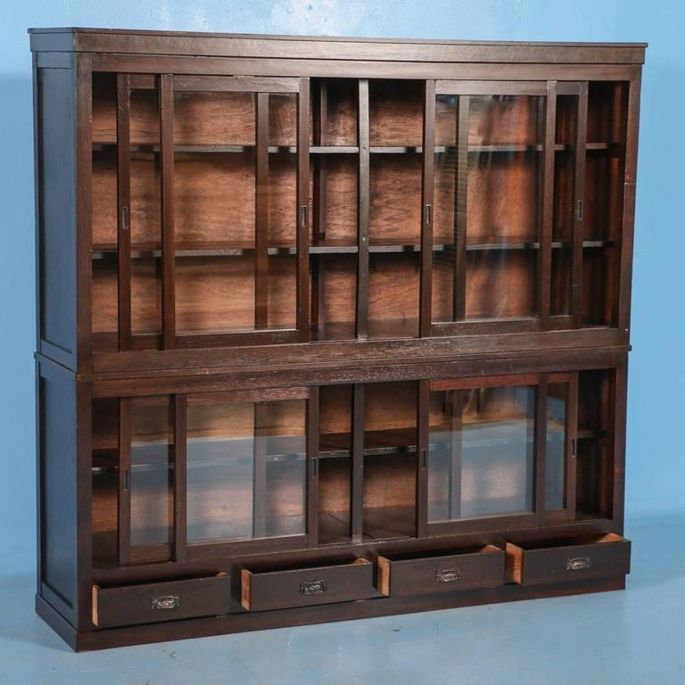 This beautiful antique Japanese bookcase has 8 sliding glass doors with  shelves inside and four drawers - Antique Japanese Bookcase Or Cabinet With Sliding Glass Doors, Circa