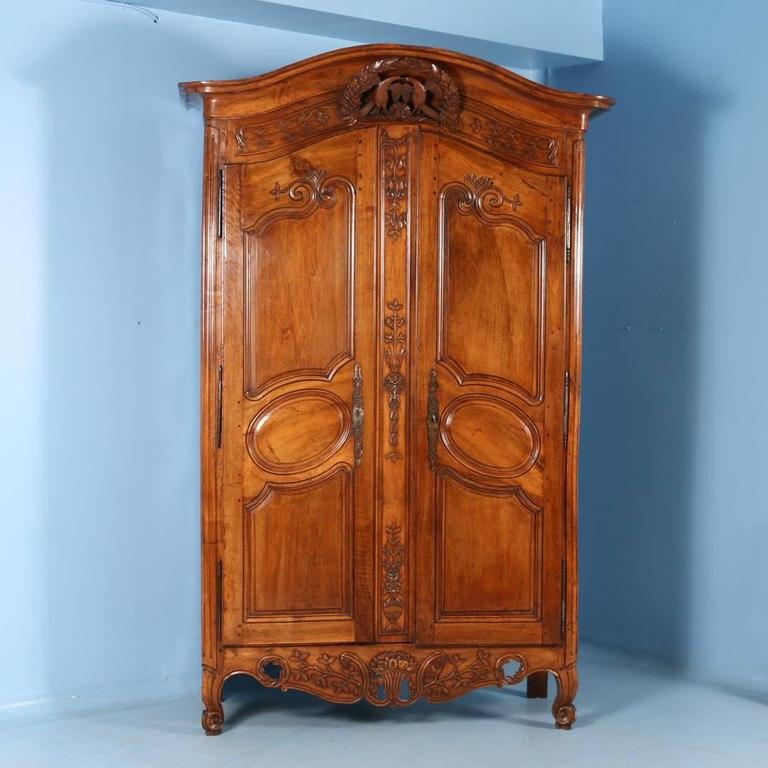 An 18th century wedding or bridal armoire from France, made of chestnut  with a stunning - Antique French Chestnut Wedding Armoire With Love Birds, Circa 1790