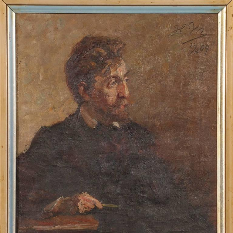 Antique oil on canvas portrait of a Danish gentleman sitting with his arm resting on a ledge holding a pen. This small painting is signed in the upper right with the initials HM and the date of 22/10 09.
