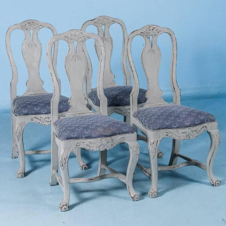 This lovely set of six dining chairs exude a graceful country charm. While likely from a Swedish farm house, these speak to a more upscale home with a touch of elegance due to the extra elements of carved details and the shapely curves of the backs