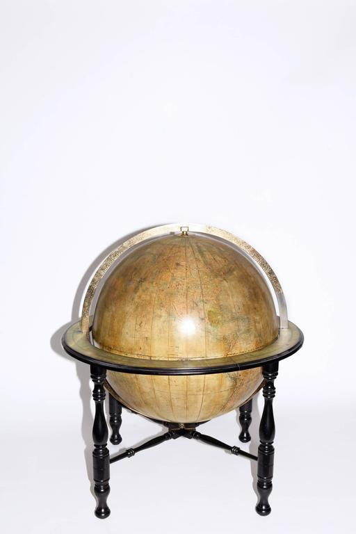30 inch diameter library globe featuring Oklahoma with Indian territory, circa 1890. Maker is Johnston, Edinburgh, Scotland, a renowned British globe producer. Mounted on ebonised turned leg Stand with cross stretchers featuring brass meridian and
