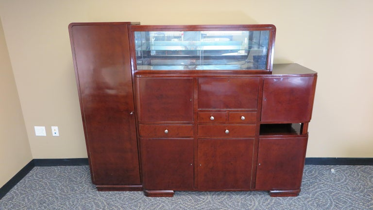 Period art deco sideboard, art deco bar cabinet. An excellent art deco sever having bar compartments, and lots of storage with a glass display case on the top.