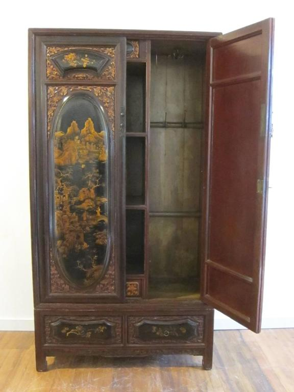 19th century gilt painted wardrobe cabinet. A very special Qing dynasty wedding cabinet elaborately decorated with fine and exceptional gilt painting. The lacquer can be referred to as having a snake like skin or (alligator-ing) this happens through