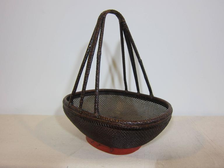 Antique market basket of woven reed, turned bamboo and wood. Decorative basket. This an actual market basket from the turn of the century 1900. In very good condition for collection and or use. Very intricate design with great attention to detail.