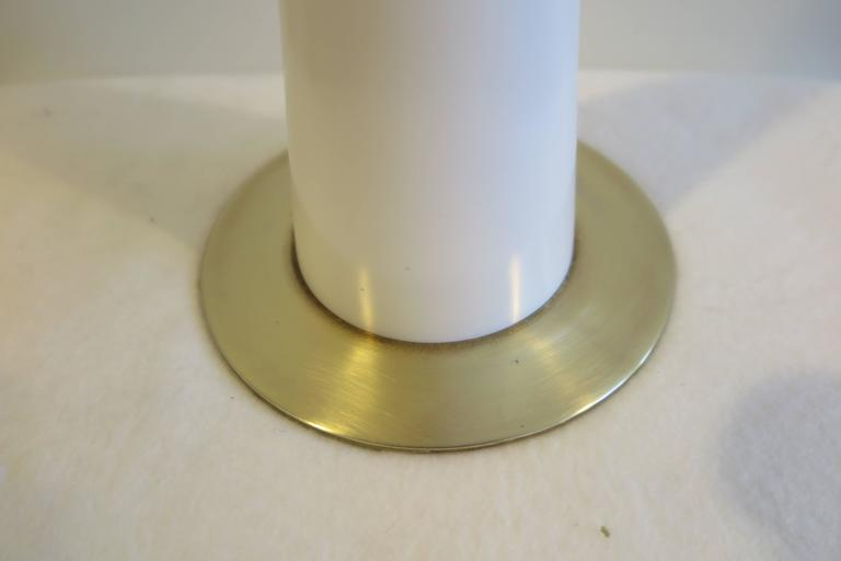 White powder coated and brass table Lamp by Stewart Ross James for Hansen. In very good condition. The white enamel powder coat finish over a metal tulip shaped cylinder define a modern  minimal design.  In very good condition having light ware to