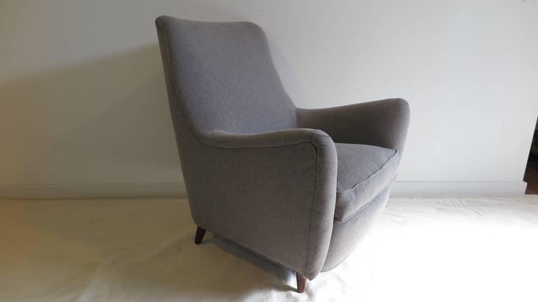 A 1950 Italian sculpted Lounge chair in the style of Gio Ponti. This is a full size chair at 32 W x 34 D x 37 H with a seat height of 18 inches. Feather cushion seat with an additional pillow.  In very good condition.