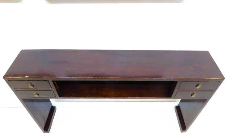 19th century compartment console table with four drawers and a middle compartment enclosed shelf area. Set on solid panel plank legs with block footing details showcasing a clean line aesthetic. This particular design was favoured in the Ming