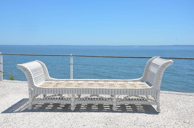 """Very large antique Heywood Wakefield Bar Harbor daybed with new webbing over tied spring platform. Fully woven skirt on all four sides standing on pinecone feet. Outside measurements are 93"""" long, 38"""" wide, 31"""" high on one end and"""