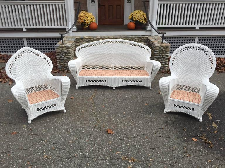 Antique Art Deco Wicker Parlor Set in fresh white paint.  Seating is large in scale and generously proportioned providing a comfortable feel.  Sofa measures 78