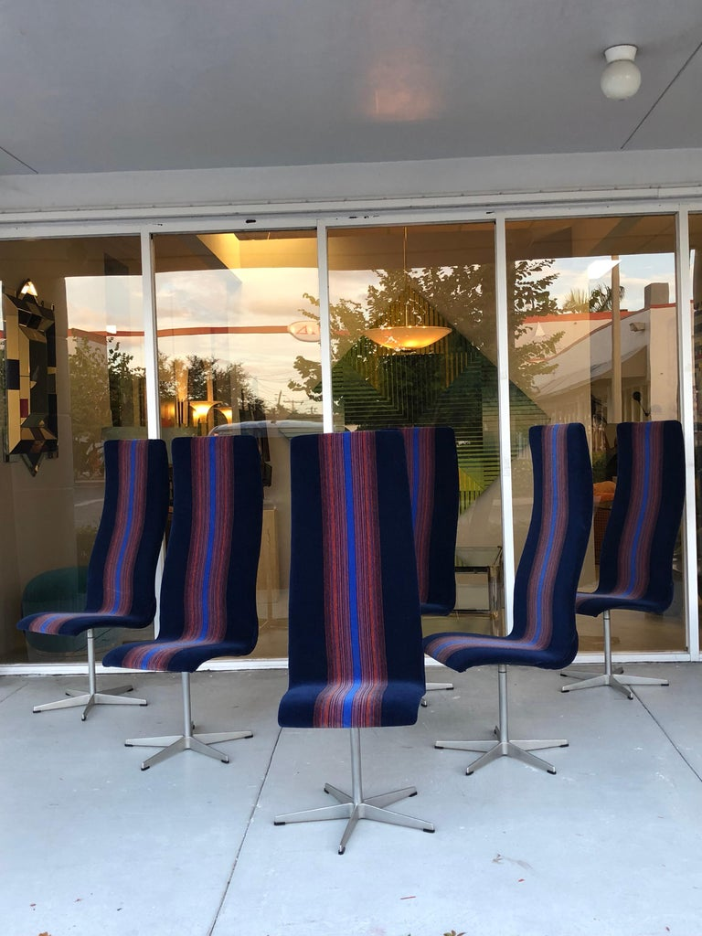 A set of six Oxford chairs. A seemingly simple design becomes the epitome of modern elegance in the hands of Arne Jacobsen. The upholstery is blue and orange mohair, possibly a fabric design by Verner Panton.