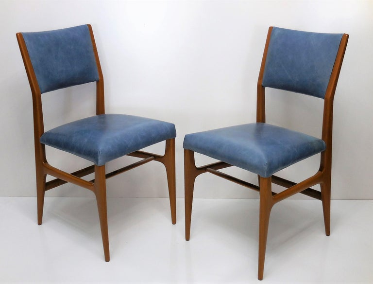 Four Gio Ponti chairs edited by Singer and Sons. Great design and craftsmanship. Subtle detail like the slight angle at the joints and slant of the curved back.