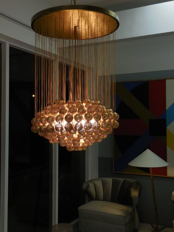 Large Brass Chandelier with Perforated Spheres by Zero Quattro 2Large Brass Chandelier with Perforated Spheres by Zero Quattro at  . Quattro Lighting. Home Design Ideas