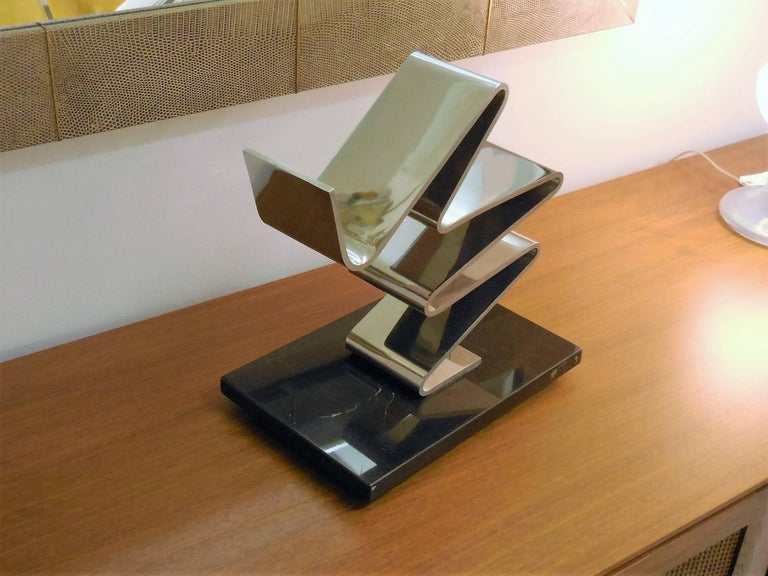 A great sculpture by american artist Kurt Larisch. It is stainless on marble base. Signed and numbered on the metal.