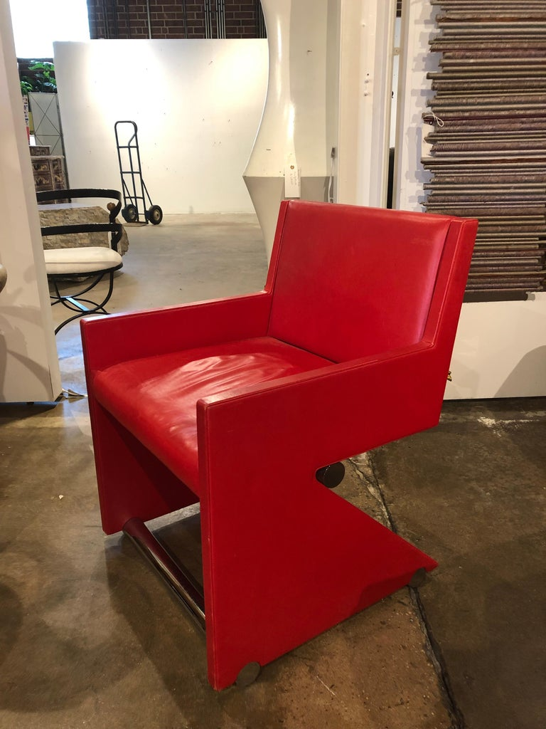 """Modern leather and chrome desk/accent chair. Measures: Arm H 22.25""""."""