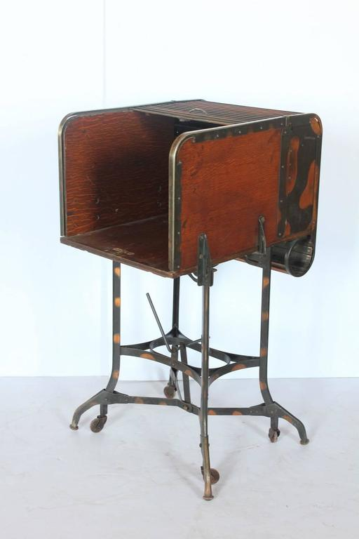 Early 1900s American Industrial roll top table by Toledo. Great as used as bar.