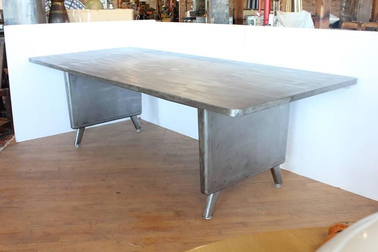 Large Machine Age Metal Desk/Dining Table. Space between legs 61.75
