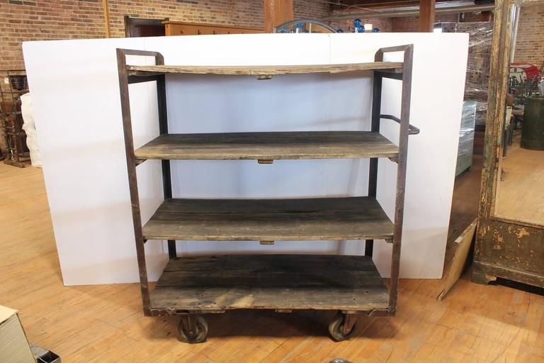 Antique Industrial shelves with metal base and wood shelves.