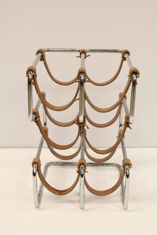 Stylish Mid-Century chrome and leather wine rack.