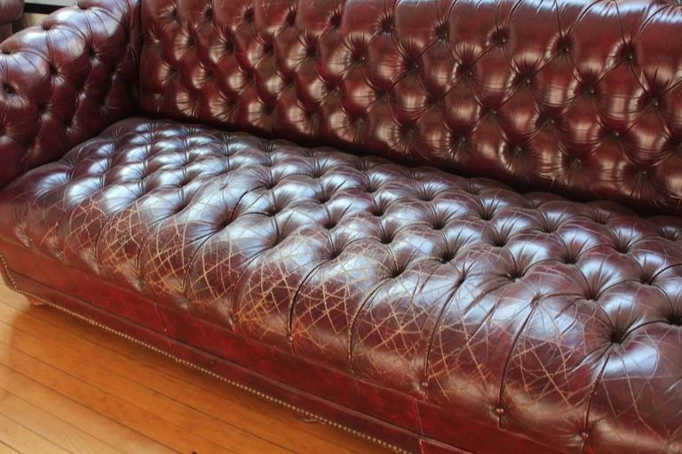 American Vintage Distressed Burgundy Leather Chesterfield Sofa For Sale