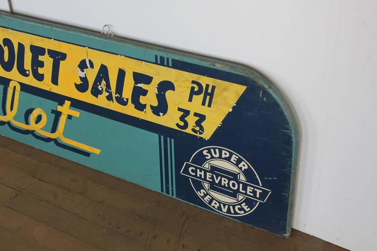 1930s hand-painted wood Chevrolet advertising sign.