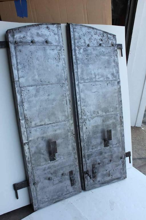 Antique distillery metal shutters. More sets available.