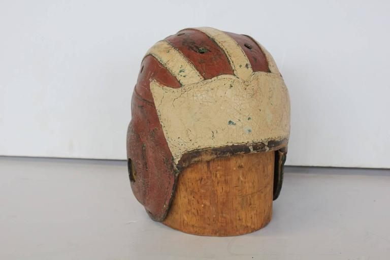 Antique football leather helmet with wood hat mold.