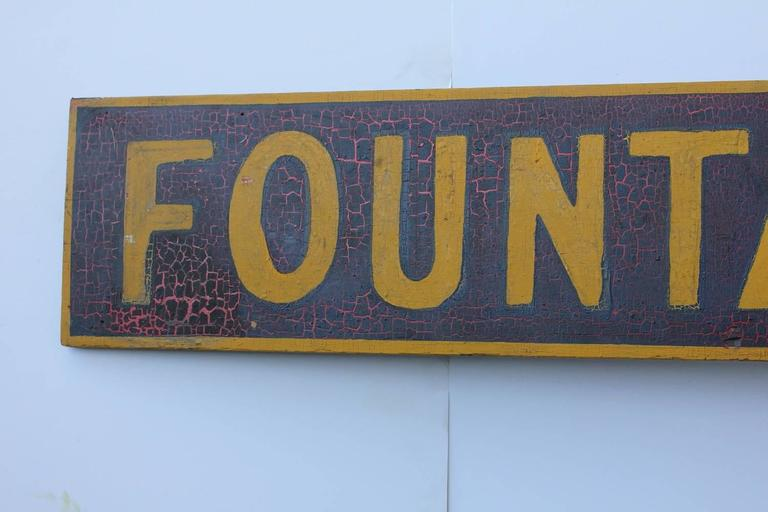 Late 19th century hand-painted wood sign
