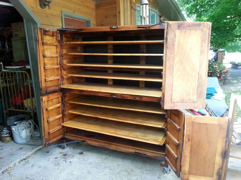 Antique, French bakery cabinet with original hardware. Shelves are moveable.