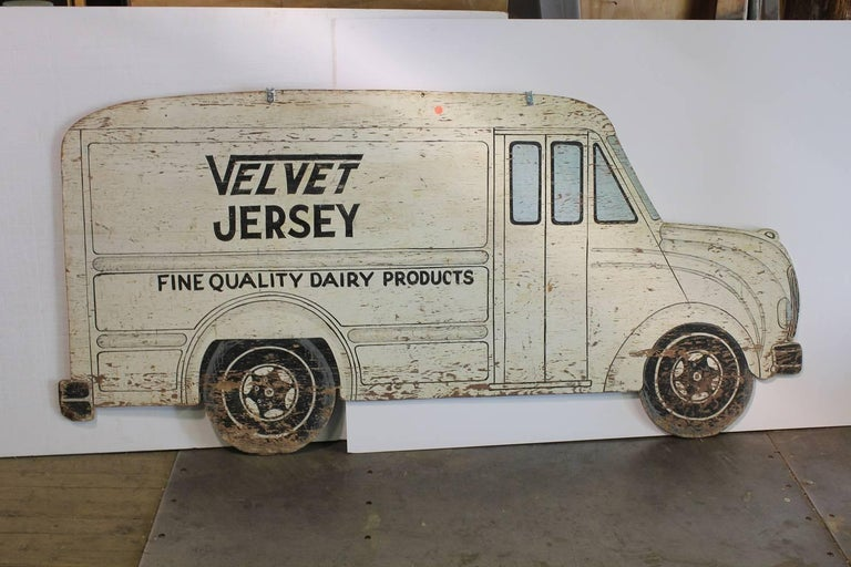 1930s double sided hand-painted milk truck wood sign.
