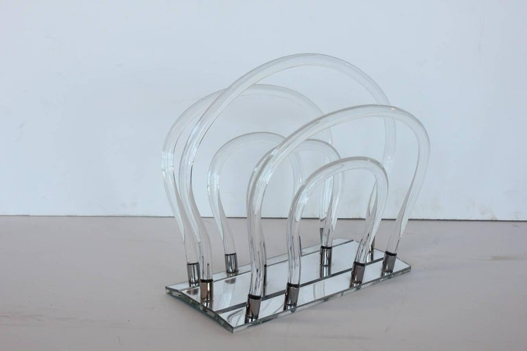 Midcentury Lucite and chrome magazine rack by Dorothy Thorpe.